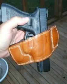 GLOCK pistol in a slide holster