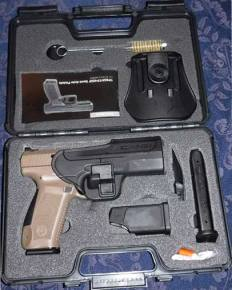Canik TP9SF 9mm pistol in the box with holster, 2 magazines, back straps, lock, load assist device, and manual