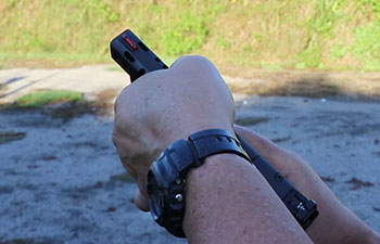 Gripping a Walther Q5 pistol slide serrations