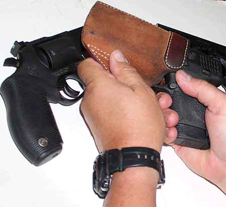 concealed carry gun inserted in holster