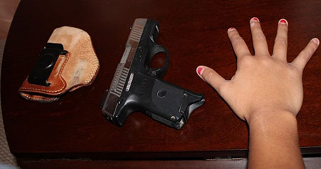 Hand size against CCW gun and holster