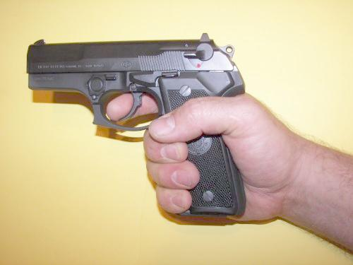 Beretta Cougar Pistol In A Shooting Grip