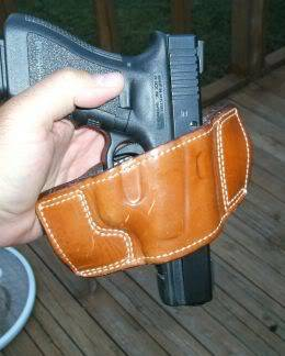 GLOCK pistol in a slide holster