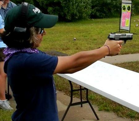 Female shooting the Ruger SR9C Pistol