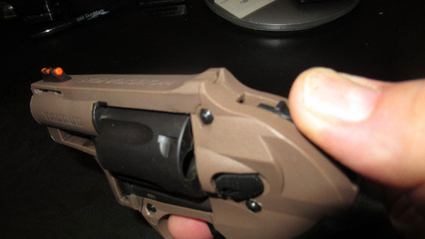 Thumb cocking the Taurus M605 Revolver