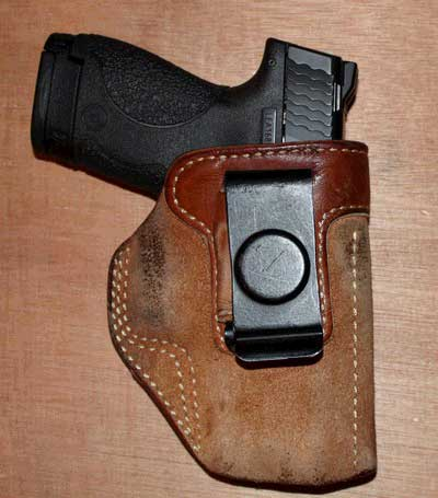 The Smith and Wesson 9mm Shield in an IWB holster made for a GLOCK
