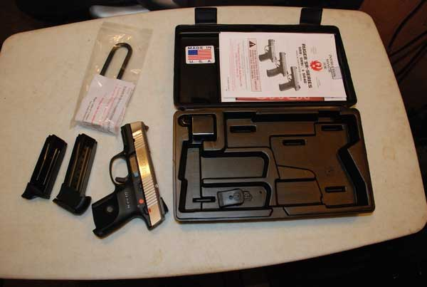 Ruger SR9C Compact Pistol Kit with case, magazines, and manual