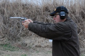 Two Hand Shooting Taurus 627 .357 Magnum