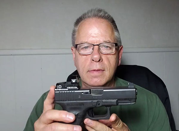 GLOCK 23 pistol with Vortex red dot sight, and tall front sight.