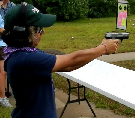 Female shooting the Ruger SR9C Pistol