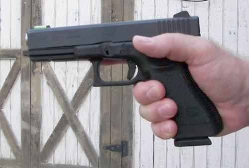 Starting Grip  with one hand on a pistol