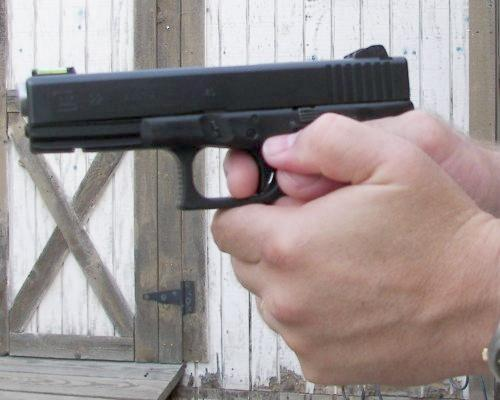 Strong Two Handed Grip On A Pistol