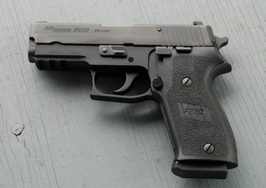 Sig P220 control side view