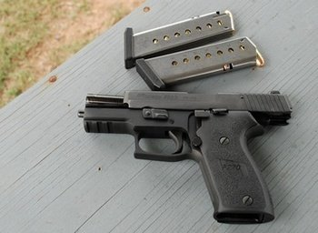Sig P220 Open slide and magazines