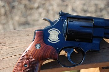 Smith and Wesson 50th Anniversary seal on the side of the revolver